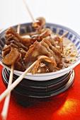 Belly pork on sticks with peanut sauce (Japan)