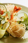 King prawns, fried in rice noodles, with courgette salad