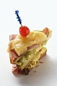 Ham & cheese on toast with pineapple, avocado cream & cherry
