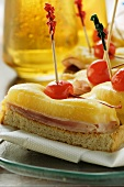 Ham and cheese on toast with cocktail cherries