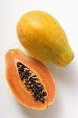Whole and half papaya