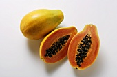 Whole and half papayas