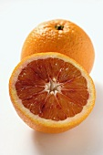 A whole and a half of a blood orange