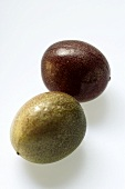Two whole passion fruits (Purple granadilla)