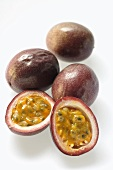 Passion fruits, one halved (Purple granadilla)