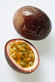 Whole and half passion fruit (Purple granadilla)