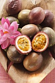 Passion fruits (Purple granadilla) in wooden bowl