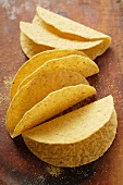 Taco shells on wooden background