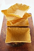 Square taco shells on chopping board
