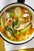 Chicken soup with vegetables in saucepan