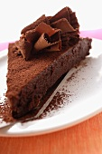 Piece of chocolate cake with chocolate curls