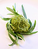 A blob of pesto with fresh tarragon