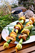 Grilled turkey kebabs with sweetcorn & vegetables in open air