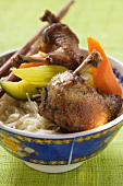 Roast pigeon with vegetables on noodles (Asia)