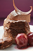 Chocolate soufflé with chocolate curls and cherries