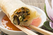 Spring roll on chilli dip