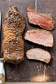 Two beef steaks, one sliced