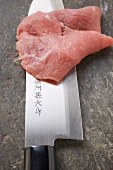 Veal escalope on Asian knife