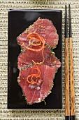 Raw tuna fillets with poppy seeds