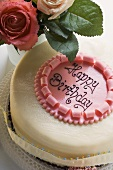 Birthday cake with the words 'Happy Birthday', roses