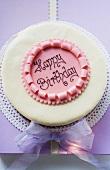 Birthday cake on pale purple box
