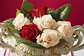 Roses in romantic stone bowl