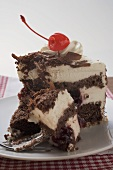 Piece of Black Forest gateau with cherry