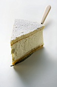 Piece of cream cheesecake on cake slice