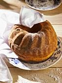 Freshly-baked gugelhupf with tea towel