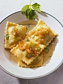 Pasta envelopes with onions and parsley