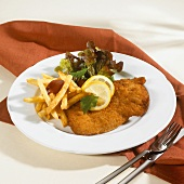 Wiener Schnitzel with chips, ketchup and salad