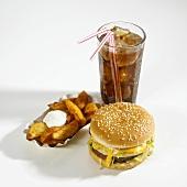 Cheeseburger, potato wedges and cola