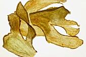 Deep-fried ginger slices, backlit