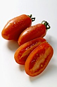 Three grape tomatoes, one halved