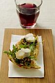 Bruschetta with fish and aubergine paste, red wine