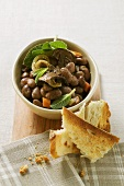 Stewed beans with ceps (Veneto)
