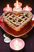 Cherry pie on heart-shaped plate for Valentine's Day