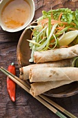 Spring rolls with salad and sweet and sour sauce (Thailand)