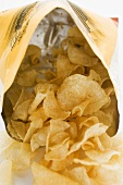 Potato crisps in opened bag