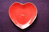 Heart-shaped red plate for Valentine's Day