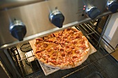 Warming up pepperoni pizza in oven