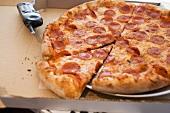 Pepperoni pizza in pizza box