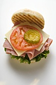 Ham, cheese, tomato and gherkin in kaiser roll
