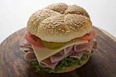 Ham, cheese, tomato and gherkin in sesame roll