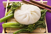 Filled yeast dumpling on pak choi (Thailand)