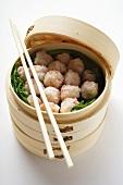 Shrimp balls in bamboo steamer (Thailand)