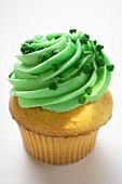 Muffin with green cream for St. Patrick's Day