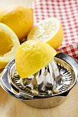 Lemons with lemon squeezer