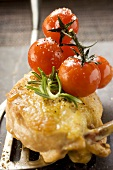 Fried chicken breast with cherry tomatoes on spatula