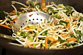 Frying vegetables in wok (close-up)